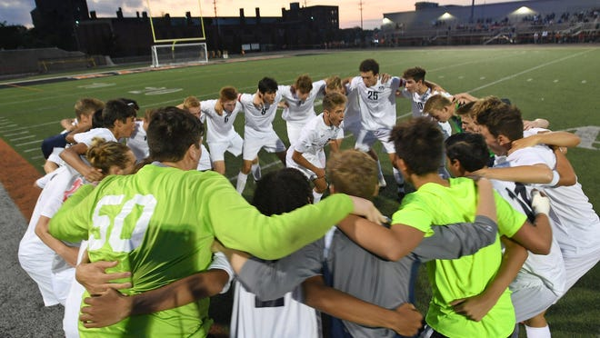 With Matt Nichilo, center, leading, McDowell players cheer together before the start of a District 10, Region 6 boys soccer game Sept. 16, 2019, at Dollinger Field at the Hagerty Family Events Center in Erie. On Friday, the PIAA voted to delay fall sports for two weeks to work with Gov. Tom Wolf's office in an effort to avoid postponing or canceling the season due to the coronavirus pandemic.