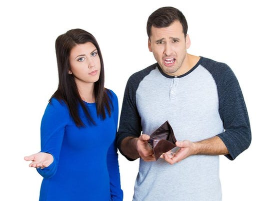 young-couple-with-no-money-empty-wallet-getty_large.jpg
