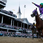 Victor Espinoza rides California Chrome to victory during the 140th running of the Kentucky Derby.