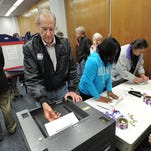 People took advantage of early voting before the November 2012 election. Glenn Goss puts his sealed ballot into the machine at the Marion County clerk's office on Monday, Oct. 8, 2012.