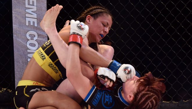 Brogan Walker beats Gabby Romero by unanimous decision in the title fight of PXC 49 at the University of Guam Calvo Field House, Aug. 7.