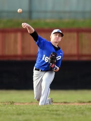 Centerville's Nolan Witte throws to first base against