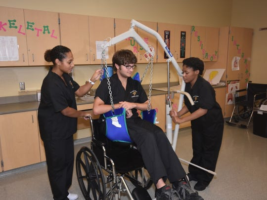 Students learn in Fort Pierce Central High School's allied health training program.
