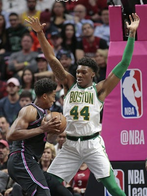 Celtics center Robert Williams defends against Heat center Hassan Whiteside during a game last season. Williams says the break in the season caused by the pandemic helped in his recovery from a hip injury.