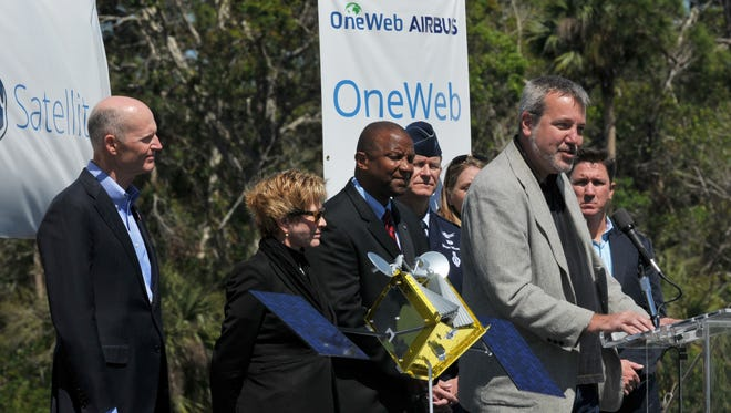 Governor Rick Scott, at left, was among those attending the Thursday groundbreaking ceremony for OneWeb Satellites Spacecraft Integration Facility, at Exploration Park. Speaking at the podium is OneWeb Satellites CEO Brian Holz.