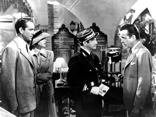 "Paul Henreid, from left, Ingrid Bergman, Claude Rains and Humphrey Bogart appear in a scene from the 1942 film ""Casablanca."""