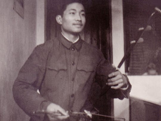 Ming Wang, 15, practices the erhu, an ancient Chinese violin, hoping to get into a Communist song and dance troupe.