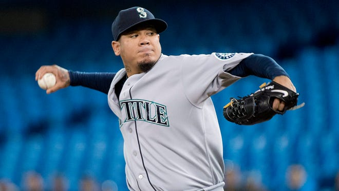 Seattle Mariners starting pitcher Felix Hernandez works against the Toronto Blue Jays during the first inning of a baseball game in Toronto on Friday, May 22, 2015.