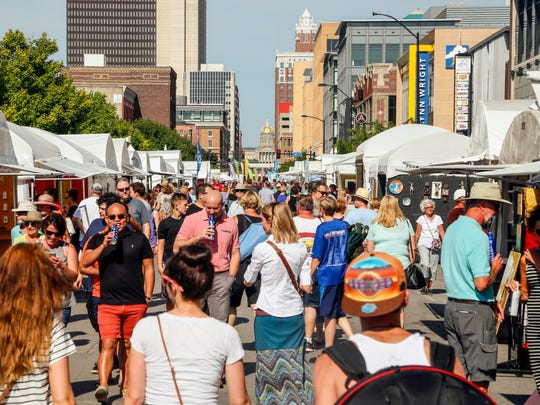 Thousands fill the Western Gateway for the Des Moines Arts Festival Friday, June 24, 2016.
