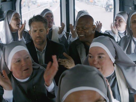 Ryan Reynolds (left, among nuns) and Samuel Jackson