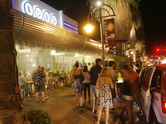 Visitors to downtown Palm Springs are dropped off in front of Lulu California Bistro Saturday night August 20,2011.  Wade Byars, The Desert Sun