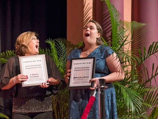 Jillian Brothers, with colleague and fellow finalist Patty Giordano, react to Brothers winning the Indian River County School District school-related employee-of-the-year award.