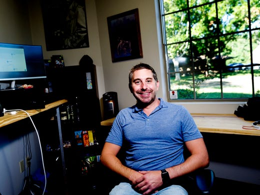 Jason Hubbard poses for a portrait in his office at
