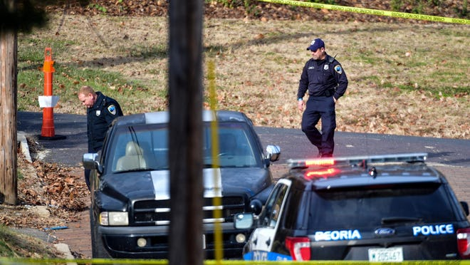 In this Journal Star file photo from Nov. 19, 2018, Peoria Police crime scene investigators look over a homicide scene just north of the intersection of W. Percy Baker Jr Ave. and North Sand Street in Peoria.