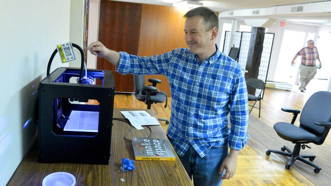Dan Fulk talks about their Makerbot Replicator 3D desktop printer at Staunton Maker Space, which he co-organized, in Staunton on Tuesday, June 3, 2014. The printer is one of the tools that will be available for use by members.