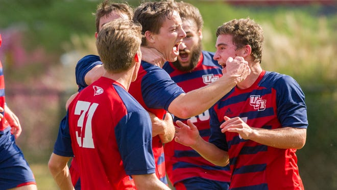 USI's Stephen Tuma (center) celebrates with team mates Brandon Williams (31) Riley Belding (24) Hayden Sovar (15)and Sean Rickey (3) after scoring the only goal in the second period in the opening round of GLVC Tournament against University of Missouri-St. Louis at Strassweg Field in Evansville, Ind. Sunday afternoon, Oct. 30, 2016.