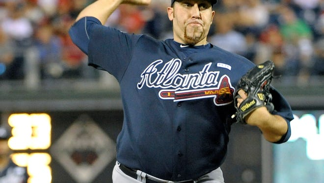 Atlanta Braves starting pitcher Aaron Harang (34) throws a pitch during the second inning Sept. 24 against the Philadelphia Phillies at Citizens Bank Park. Harang signed with the Phillies on Monday. Credit: Eric Hartline-USA TODAY Sports