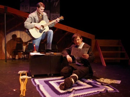 From left, the Balladeer (Aron Wesolowski) underscores the final moments of John Wilkes Booth (Evan Ross.)