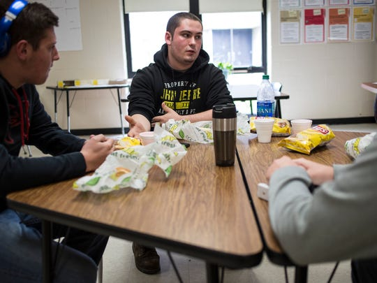Kyle Pond, 16, talks with his classmates about plans for the River Rec Teen Zone during lunch Friday, April 22, 2016 at Riverview East High School in Marine City. Pond, who is leading the initiative for the teen center, came up with the idea as part of a class project.