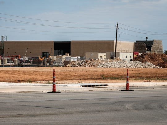 Crews continue construction of an H-E-B grocery store