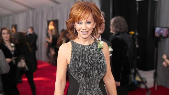 Country singer Reba McEntire arrives at the Grammy Awards in New York Sunday.