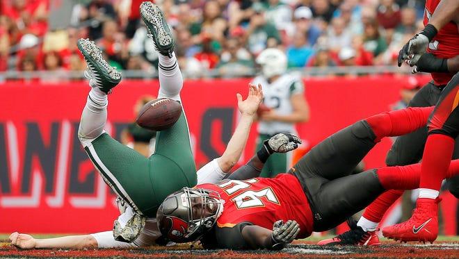 Tampa Bay Buccaneers defensive end Will Clarke sacks New York Jets quarterback Josh McCown during the first half at Raymond James Stadium.