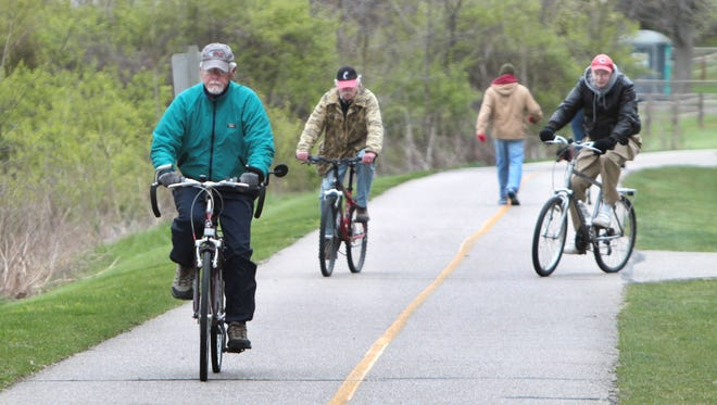(l-r) Joe Staft, of Glendale, Don Schott, of Sayler Park and John O'Connor, of Western Hills, make their daily eight-mile bike ride on the path at Miami Whitewater Forest in western Hamilton County.  Great Parks of Hamilton County is expected to expand the park by 273 acres, purchasing adjacent properties.   The Enquirer/Patrick Reddy