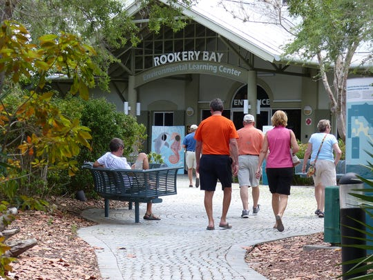 File: People walk inside the Rookery Bay Reserve in Naples.