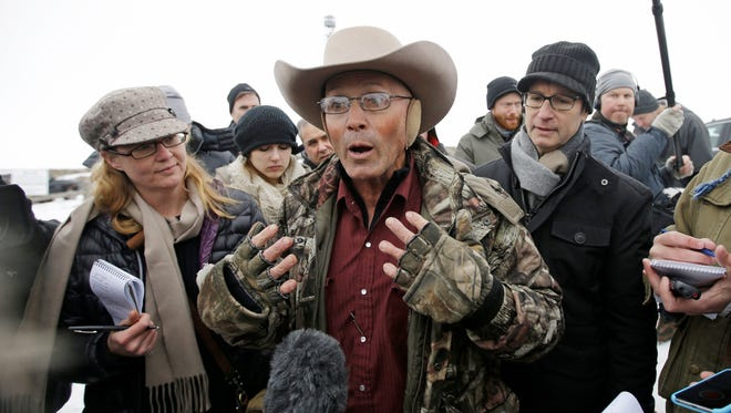 "In this Jan. 5, 2016, file photo, Robert ""LaVoy"" Finicum, center, a rancher from Arizona, talks to reporters at the Malheur National Wildlife Refuge near Burns, Ore."