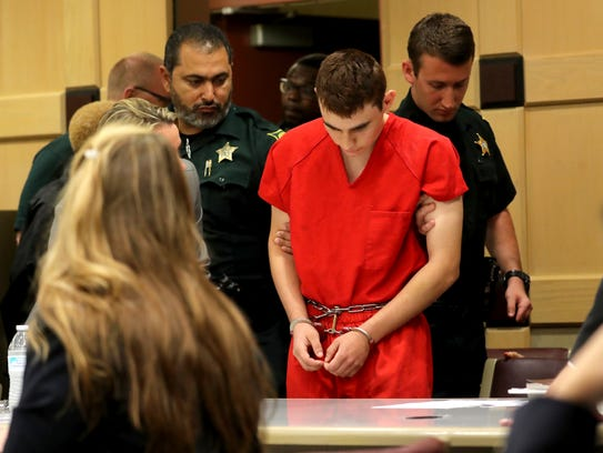 Nikolas Cruz appears in court for a status hearing before Broward Circuit Judge Elizabeth Scherer Feb. 19, 2018, in Fort Lauderdale, Fla. Cruz is facing 17 charges of premeditated murder in the mass shooting at Marjory Stoneman Douglas High School in Parkland.