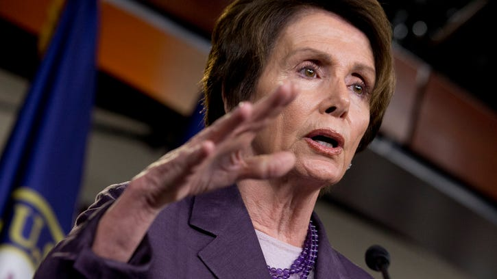 This May 9 file photo shows House Minority Leader Nancy Pelosi, D-Calif House Democrats will participate in the special, Republican-led select committee investigating the deadly 2012 attack in Benghazi, Libya, despite serious concerns within the party that the inquiry is an election-year ploy to energize core GOP voters.
