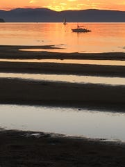 Exposed sand bars extend into Lake Champlain on Wednesday