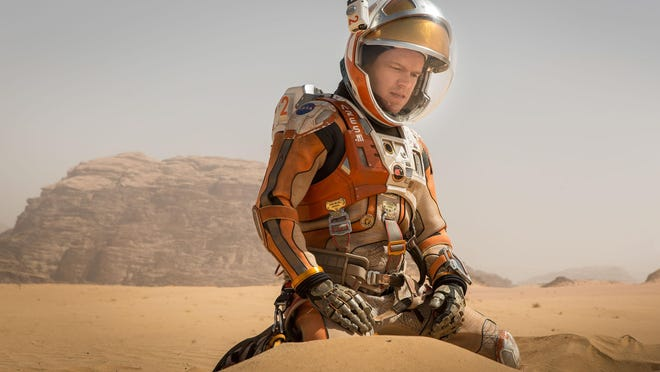 "Matt Damon portrays an astronaut who faces seemingly insurmountable odds as he tries to find a way to subsist on a hostile planet in ""The Martian."""