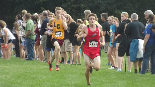 Seymour senior Dylan Deschler closes in on the finish with Luxemburg-Casco junior Hunter Liebeck in close pursuit at the Jim Bremser Memorial Invite at Mishicot on Thursday. Deschler placed fourth in the boys varsity cross-country race, while Liebeck finished fifth.