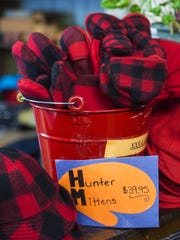 Red plaid hunter mittens for sale at Johnson Woolen Mills in Johnson on Tuesday, November 15, 2016.