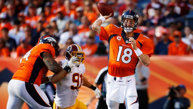 Denver Broncos quarterback Peyton Manning (18) throws the ball during the first half against the Washington Redskins at Sports Authority Field at Mile High.