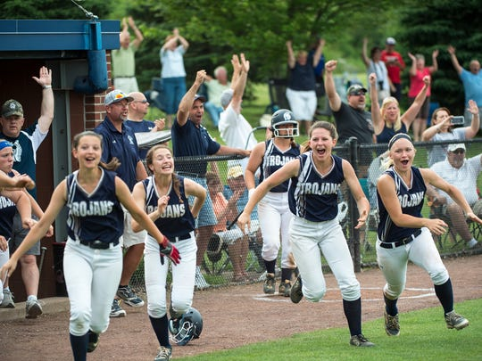 The Trojans rush the field after winning the District 3 Class AAAA softball championship against Penn Manor on Thursday, June 2, 2016. Chambersburg defeated Penn Manor 1-0 in 10 innings on a hit by Maggie Myers.