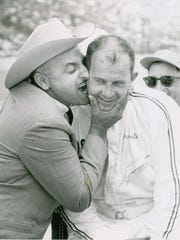 1963 winner Parnelli Jones, shown here being gnawed by car owner J.C. Agajanian, was thinning in a major way but retained enough of a tuft to craft into a credible flat-top.