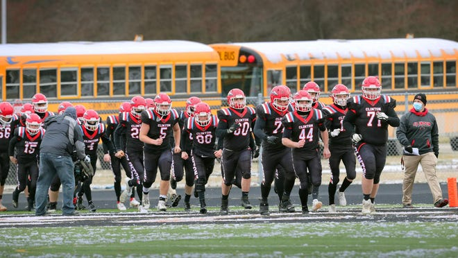 The Clinton football team runs onto the field at Tecumseh prior to the Division 6 state semifinal against Constantine.