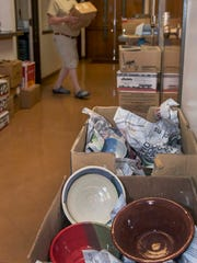 John Northcutt brings in boxes of bowls, which line the halls of St Paul's Methodist Church, for the 25th Anniversary Empty Bowls fundraiser for the El Caldito Soup Kitchen. 10/19/17 Gary Mook/ for the Sun-News