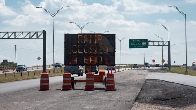 A blinking sign warns west-bound motorists that the exit ramp to Glenna is temporarily closed for repaving.
