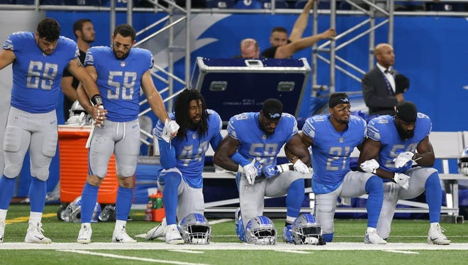 The Detroit Lions took a knee and joined arms in protest of statements made by president Trump before action against the Atlanta Falcons Sunday, September 24, 2017 at Ford Field  in Detroit, MI. Kirthmon F. Dozier/Detroit Free Press