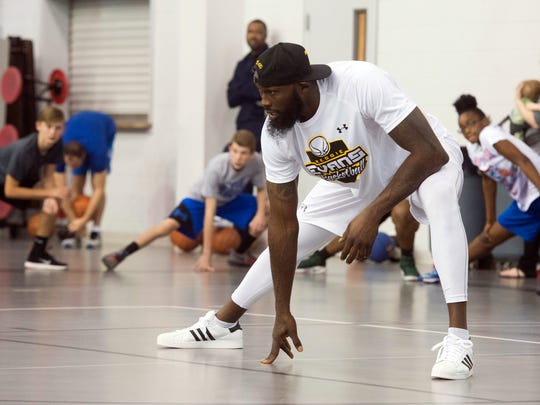 Former NBA player, Reggie Evans, holds a basketball clinic at West Florida Baptist Church in Milton Monday morning Feb. 20, 2017. During the clinic, Evans taught a middle and high school students a variety of ball handling skill and footwork drills.