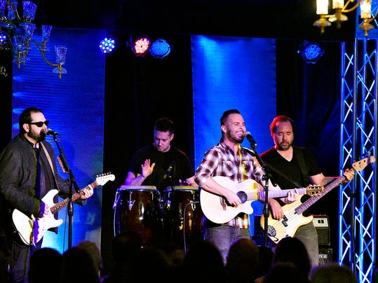 From left, Chad Taylor, on guitar,  Chad Gracey, on drums, lead singer Chris Shinn, and Patrick Dahlheimer, on bass, of the rock band Live, perform at the Wyndham Gardens Hotel during Starbucks' anniversary celebration of 20 years at the York roasting plant in York, Pa. on Tuesday, Sept. 15, 2015.  Dawn J. Sagert - dsagert@yorkdispatch.com