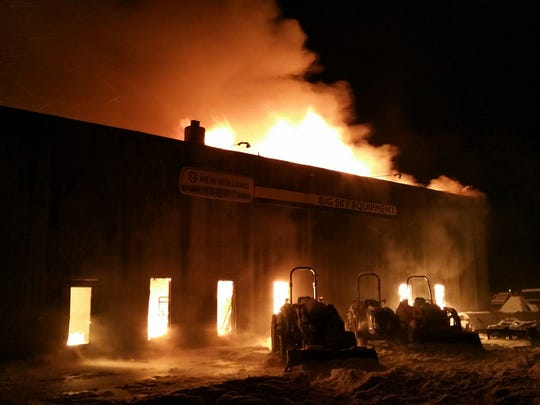 Tractors are illuminated by the Tuesday morning fire