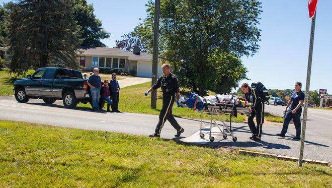 A medivac team prepares to airlift the injured driver who was involved in a two-vehicle accident in Staunton on Monday, Sept. 14, 2015.