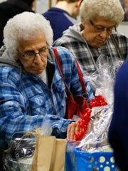 Patrons sift through silent auction items during St.