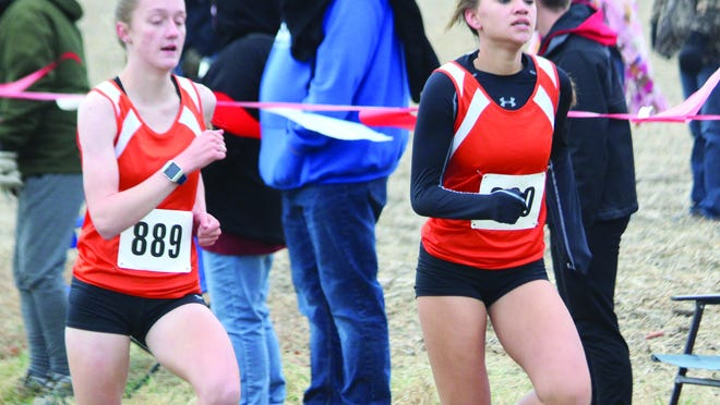 Macomb's Olivia Bishop (889) and Khyliegh Diggs (890) run for the Bombers at Saturday's Liberty Regional. For more pictures from regionals, visit www.mcdonoughvoice.com
