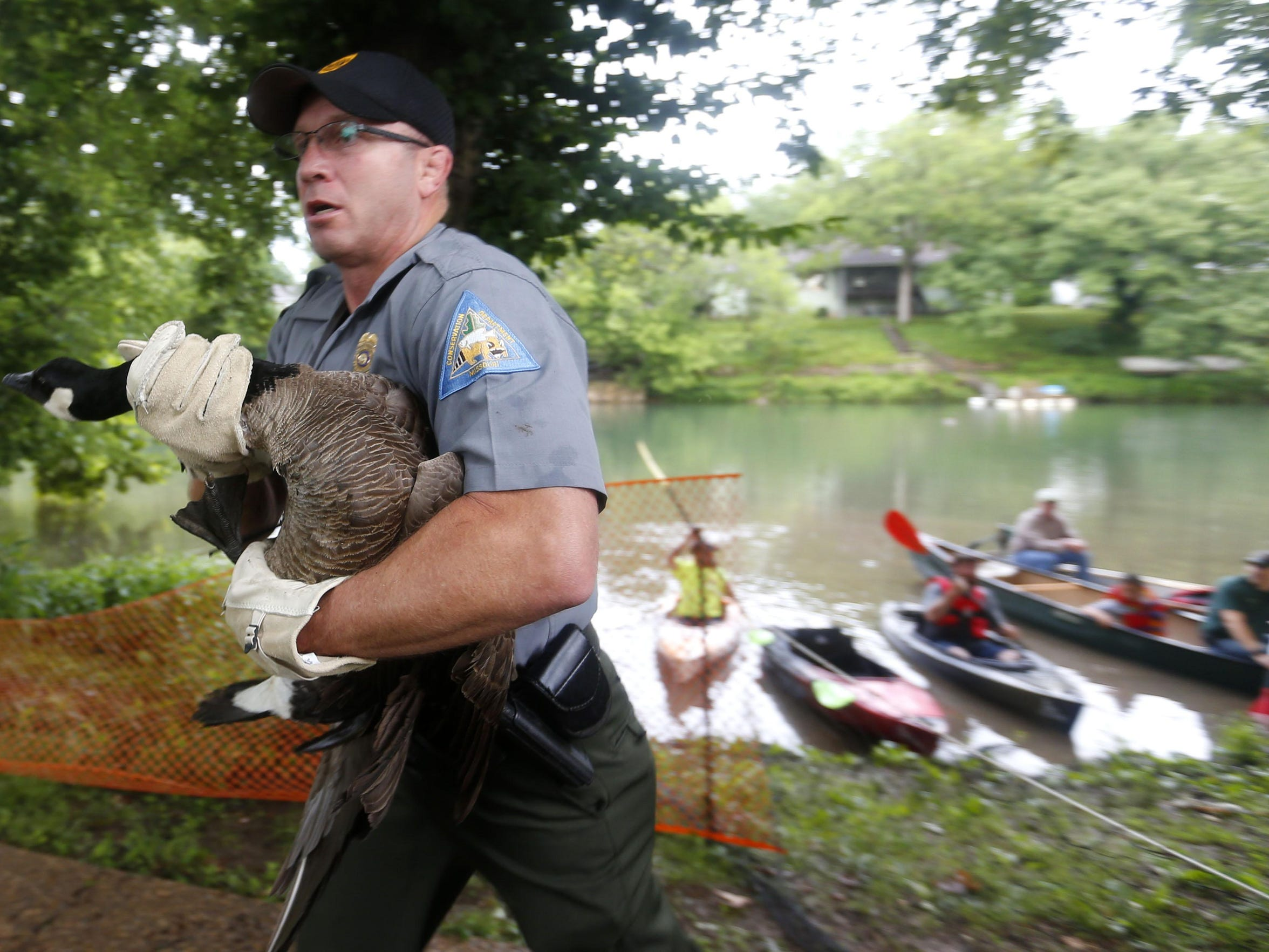 Christian County conservation agent Jeff Harris carries