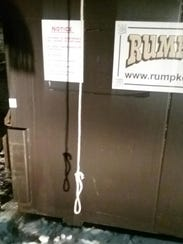 This rope was found hanging from a dumpster outside
